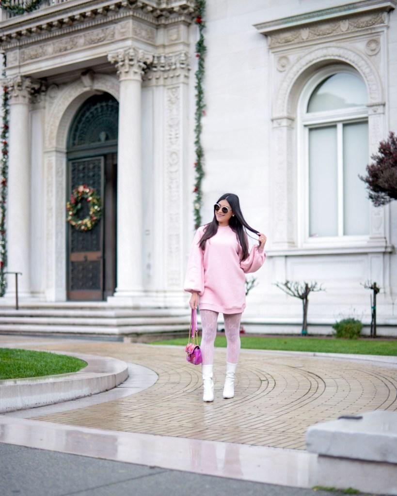 lifestyle blogger Kelsey Kaplan of Kelsey Kaplan Fashion wearing pink sweatshirt dress and Gucci purse