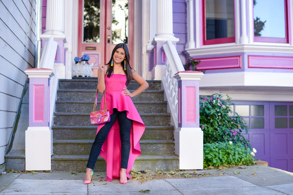 Lifestyle blogger Kelsey Kaplan of Kelsey Kaplan Fashion wearing magenta high-low top and pink Gucci matelassé purse.