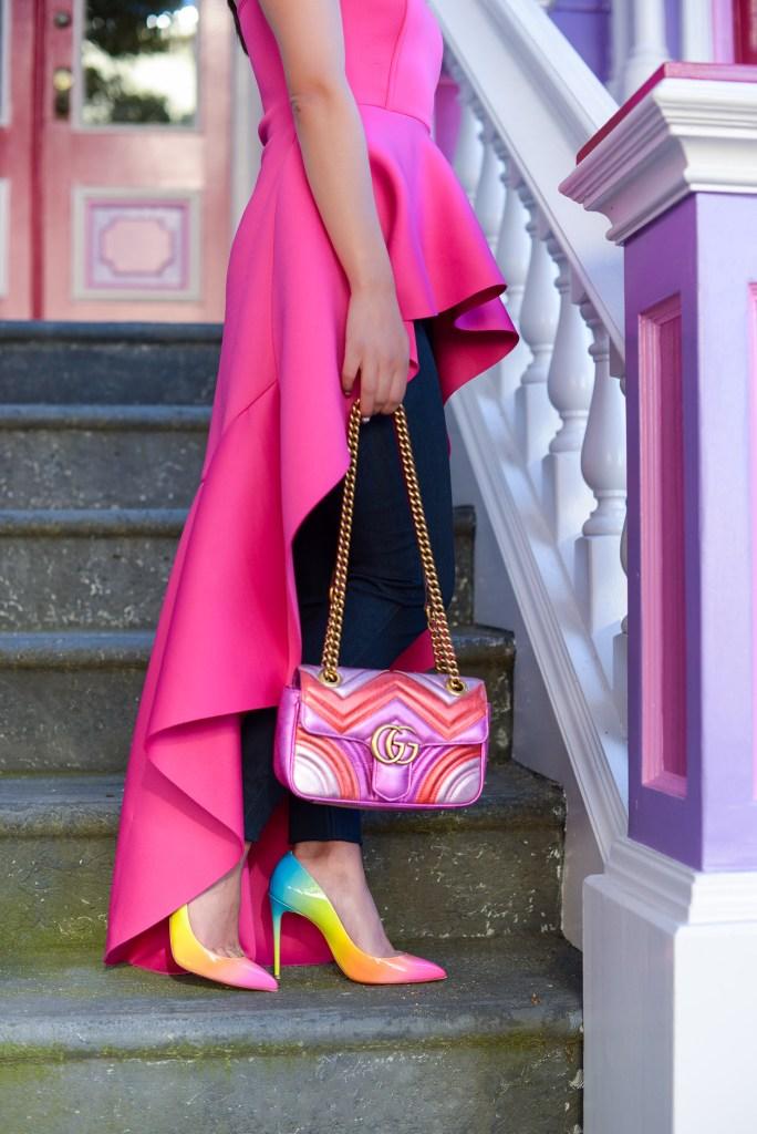 Lifestyle blogger Kelsey Kaplan of Kelsey Kaplan Fashion wearing magenta high-low top and pink Gucci matelassé purse.