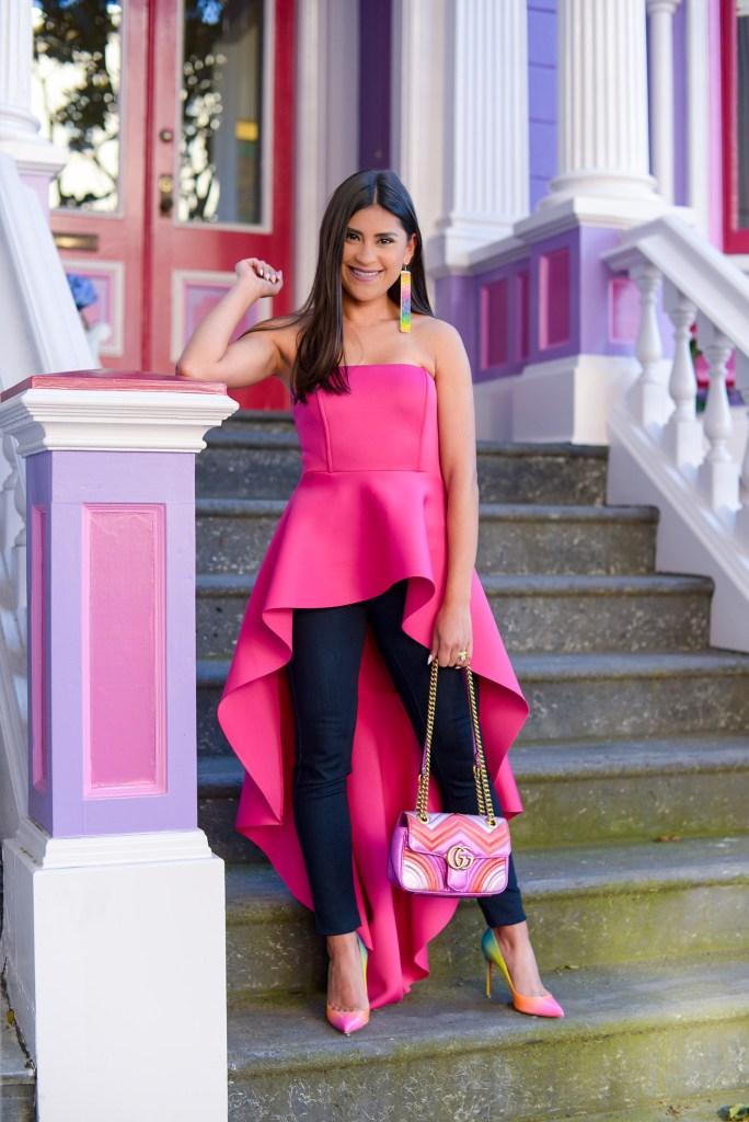 Lifestyle blogger Kelsey Kaplan of Kelsey Kaplan Fashion wearing magenta high-low top and rainbow Louboutins