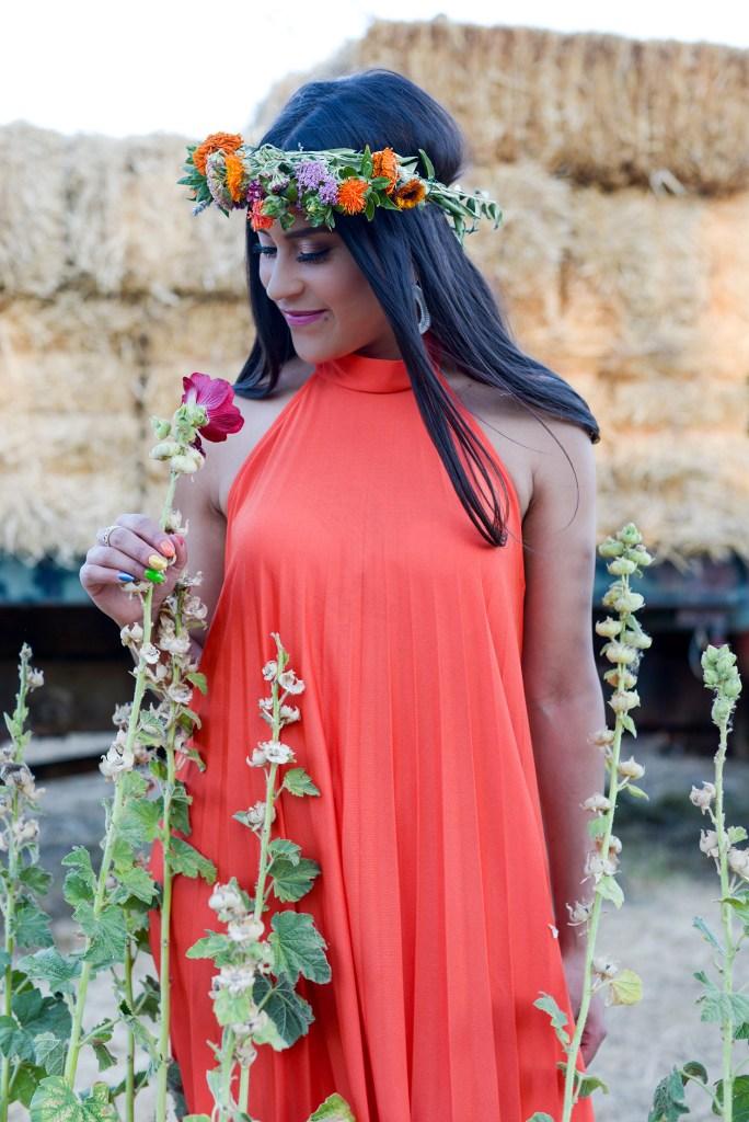 Lifestyle blogger Kelsey Kaplan of Kelsey Kaplan Fashion wearing orange maxi dress and flower crown.