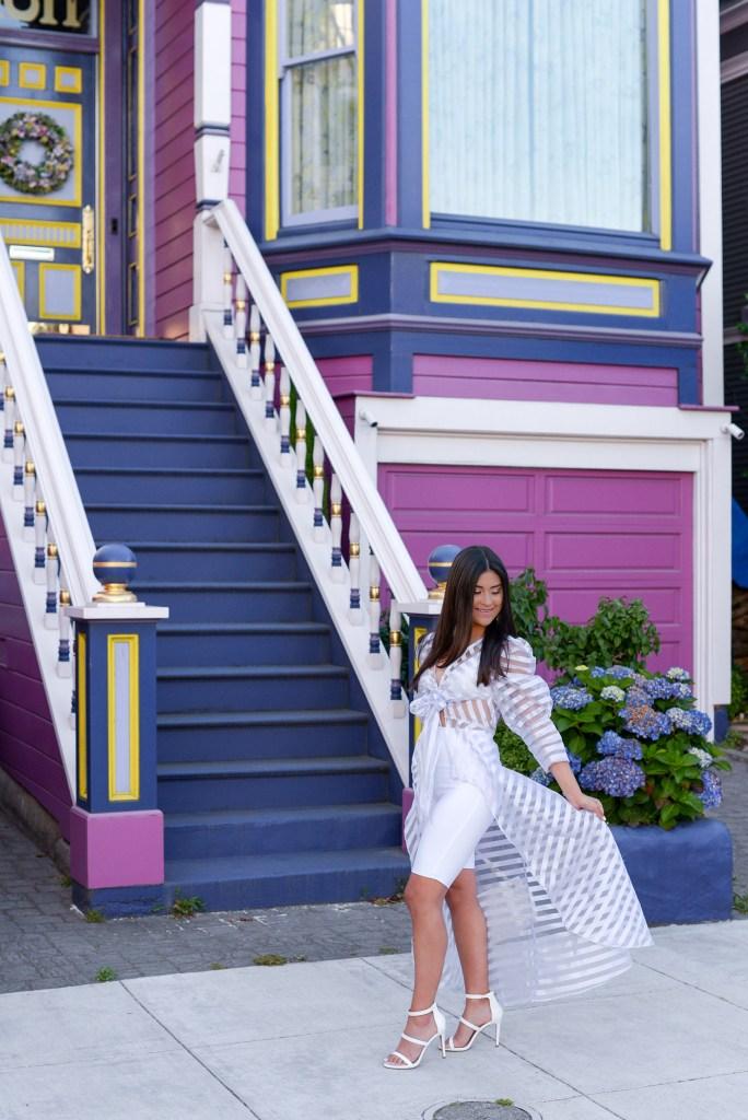 Lifestyle blogger Kelsey Kaplan of Kelsey Kaplan Fashion wearing biker shorts and white Gucci purse.