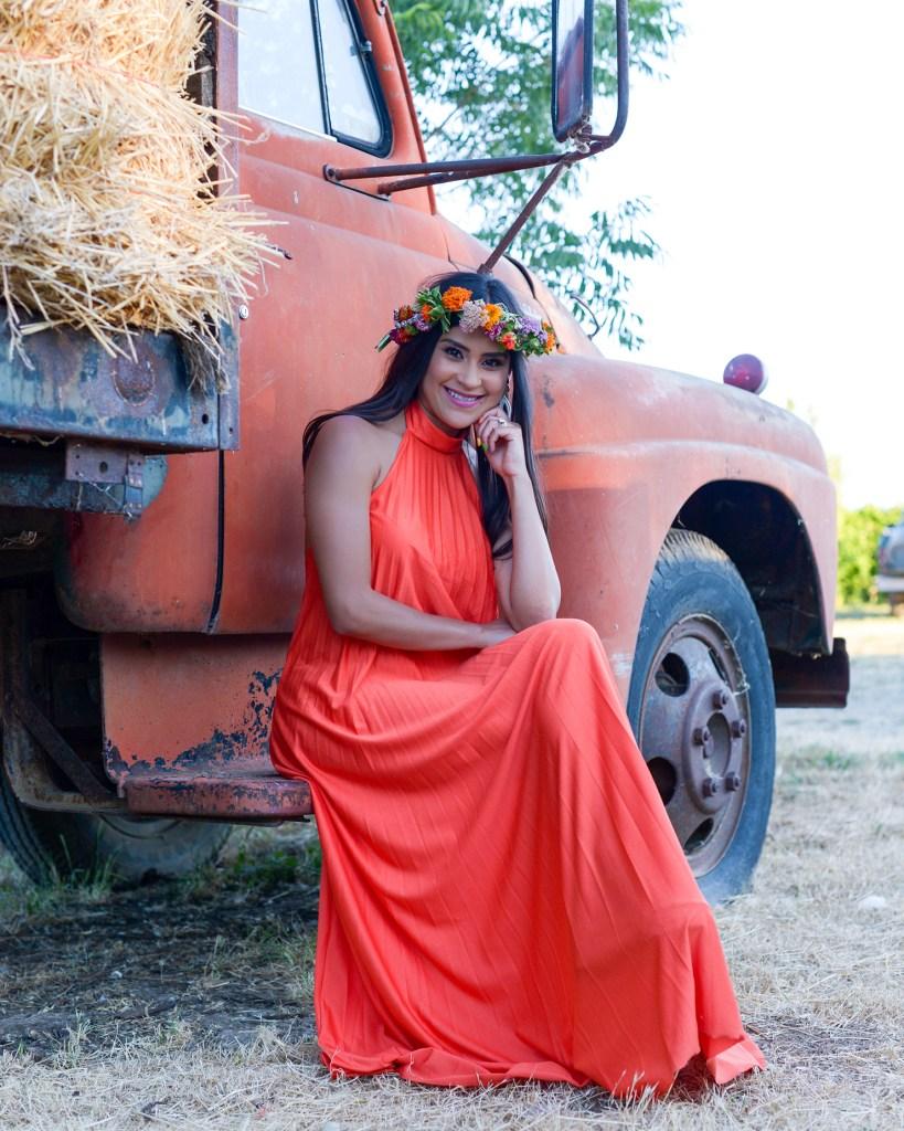 Lifestyle blogger Kelsey Kaplan of Kelsey Kaplan Fashion wearing petite orange maxi dress and flower crown.