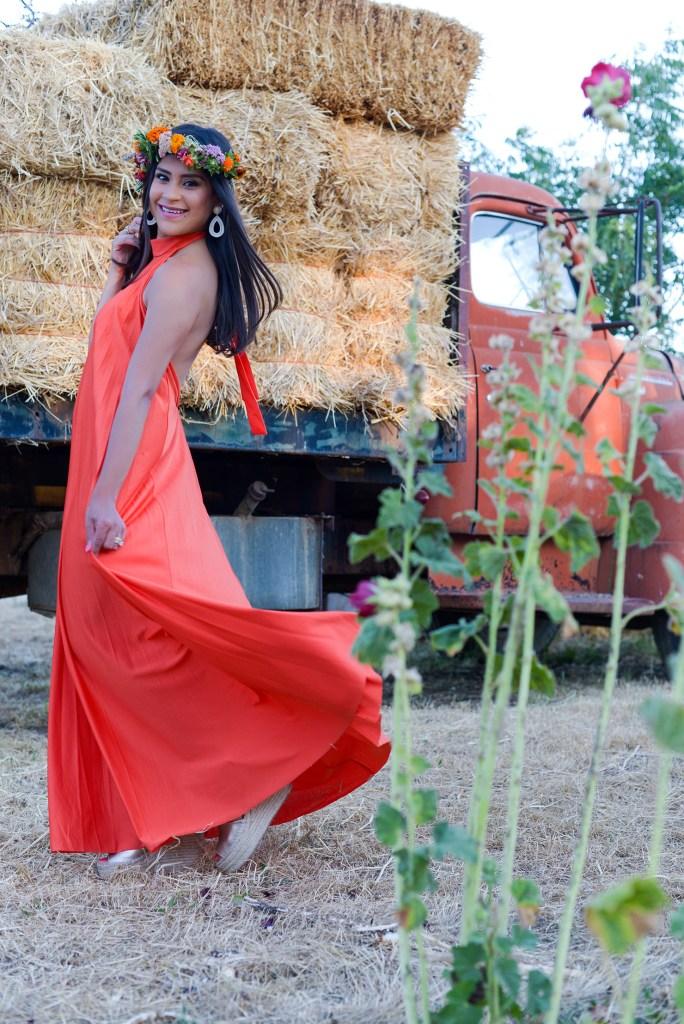 Lifestyle blogger Kelsey Kaplan of Kelsey Kaplan Fashion wearing orange maxi dress and gold wedge shoes.