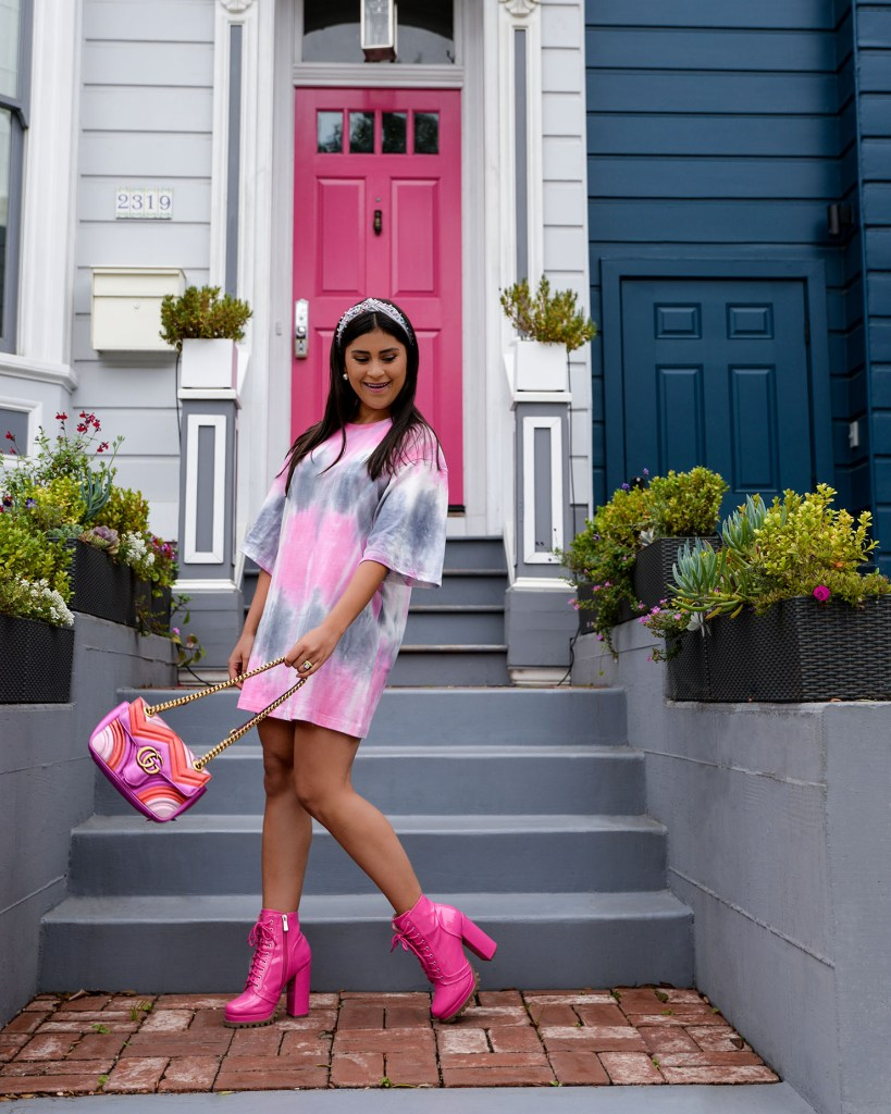 Lifestyle blogger Kelsey Kaplan or Kelsey Kaplan Fashion wearing tie dye t-shirt dress and combat boots.