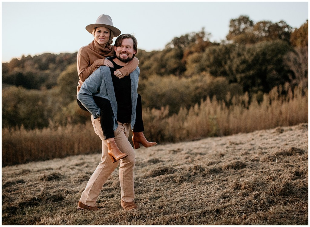 couple walking through tennessee field during engagements