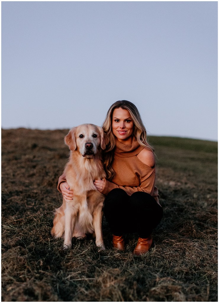 woman hugging her golden retriever during engagement session