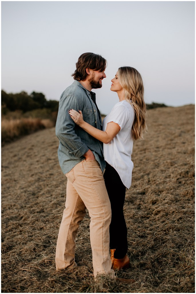 couple hugging in tennessee field after proposal