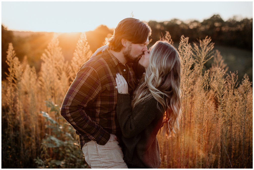 couple kissing during golden hour engagements