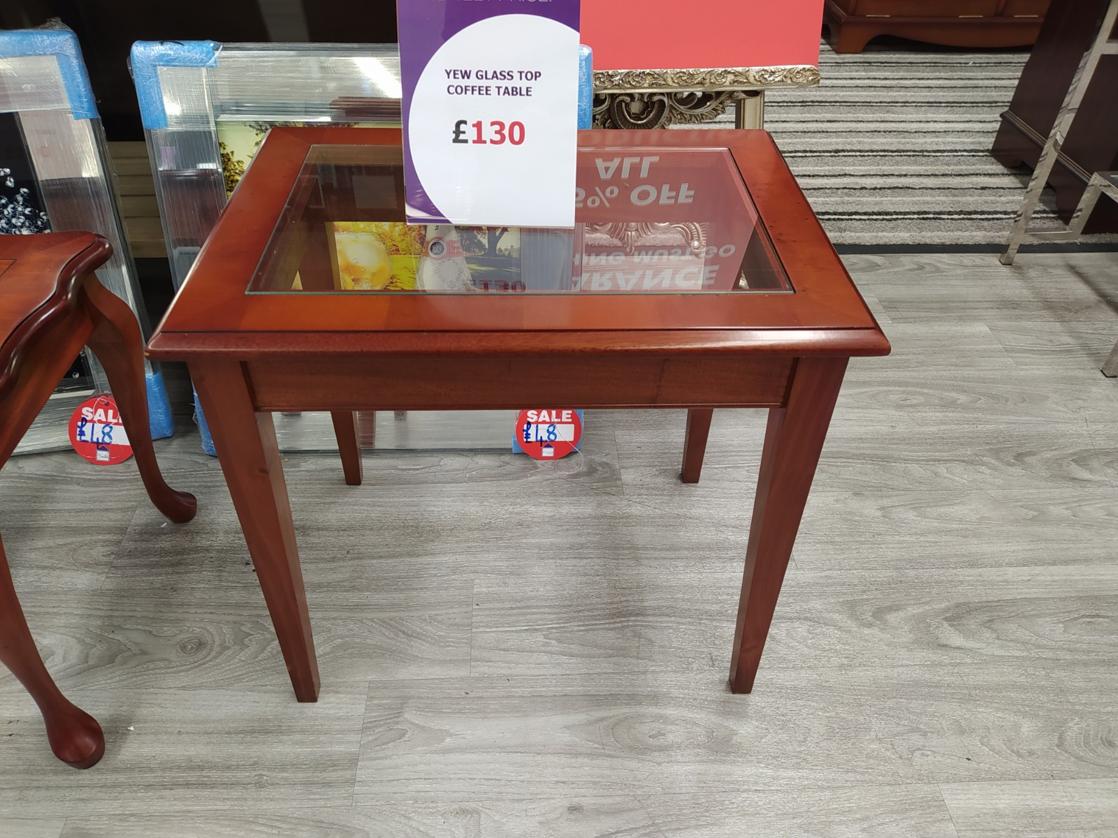 yew finish glass top coffee table