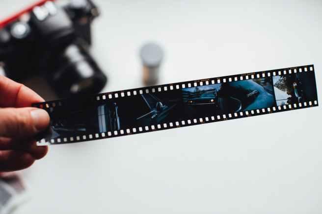 person holding film strip