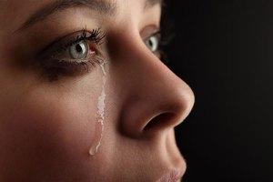 Woman shedding a tear