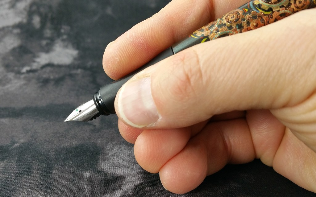 Holding the Schneider Glam Fountain Pen, it's actually a very comfortable pen to use
