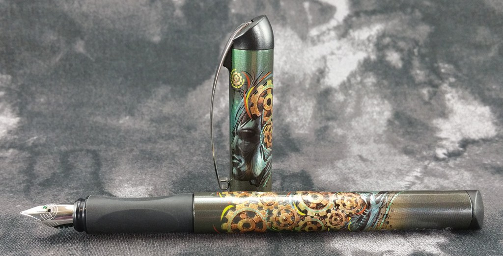 The Schneider Glam Fountain Pen laying down with the cap standing up behind it