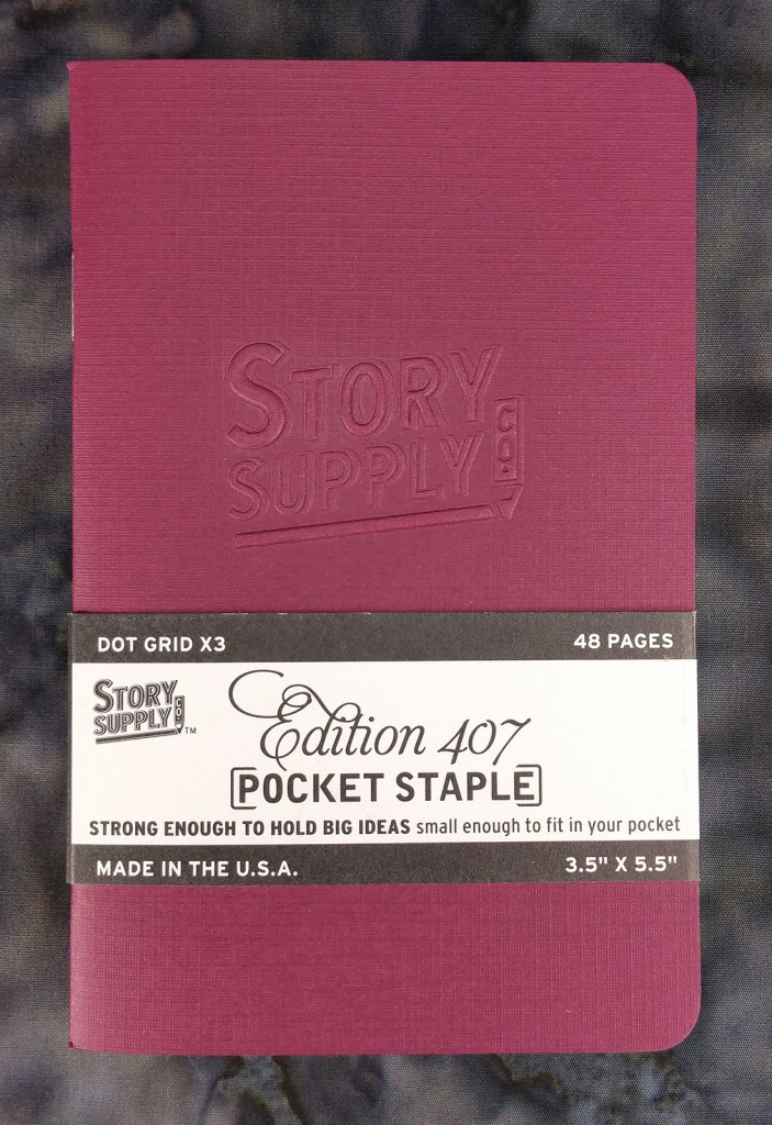 Three pack of Story Supply Co. Pocket Staple Edition 407 notebooks with the belly band.