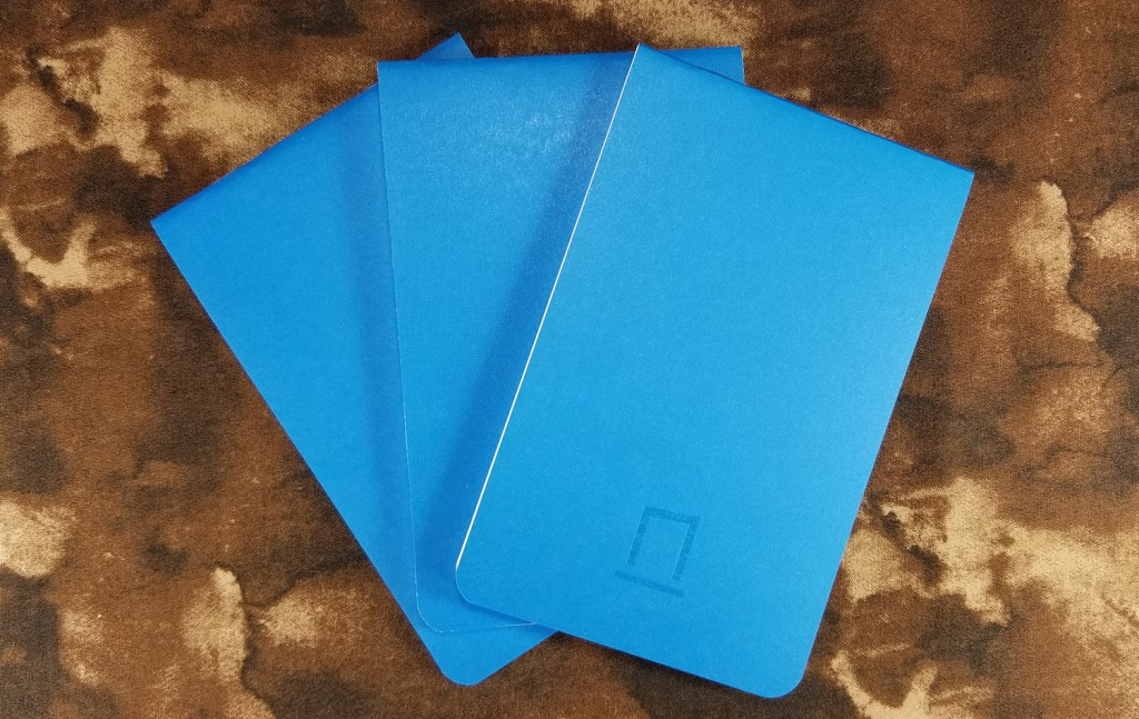 Three Nock Co. Nikko Blue DotDash pocket notebooks, fanned out.