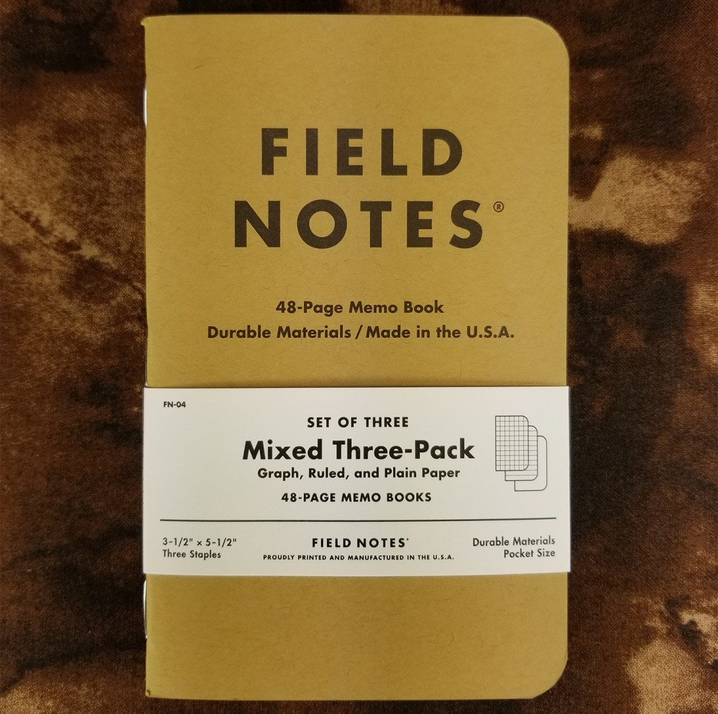 Mixed three-pack of Field Notes Kraft notebooks with the belly band.