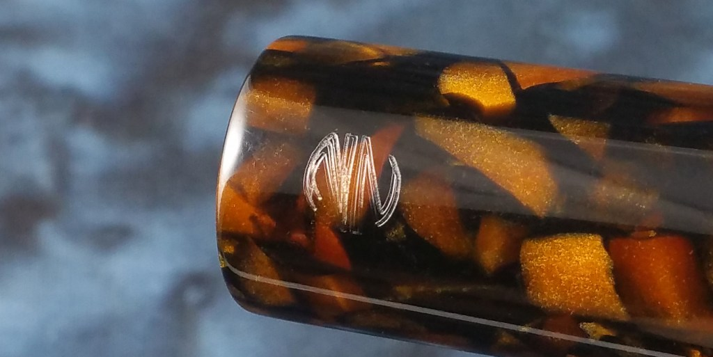 A close shot of the Newton Pens Eastman Fountain Pen's engraved logo, showing the slight misalignment of the engraving
