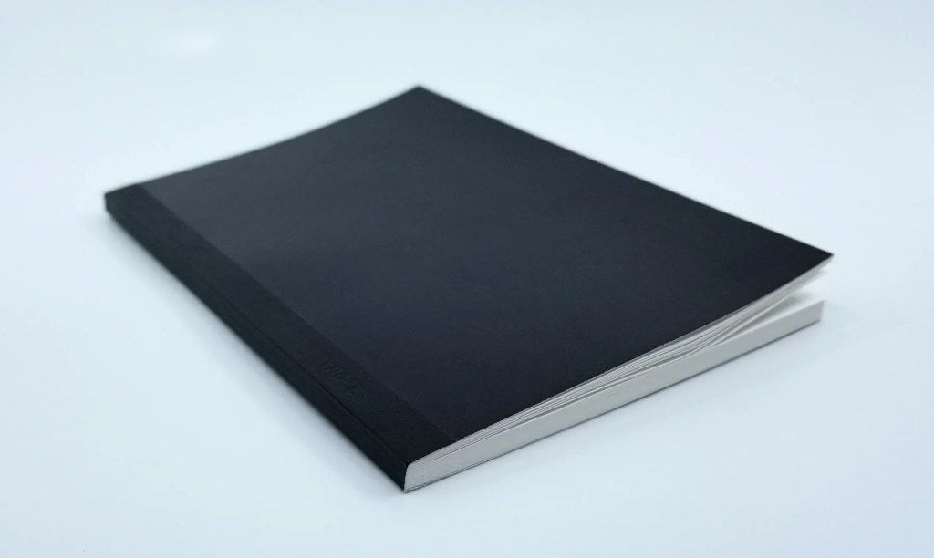 A photo of the Kokuyo Systemic A6 Notebook Refill, showing the front cover, thickness, and binding