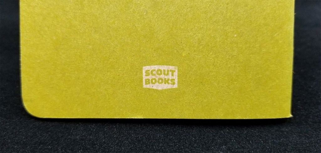 The small, nondescript Scout Books logo on the back cover of their pocket notebook; the only marking on the outside of the cover at all