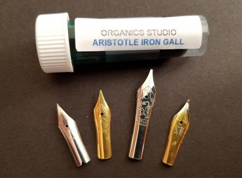 The four nibs (Pilot, Bock, Knox, and Jowo) positioned with the sample of Organics Studio Aristotle Iron Gall ink.