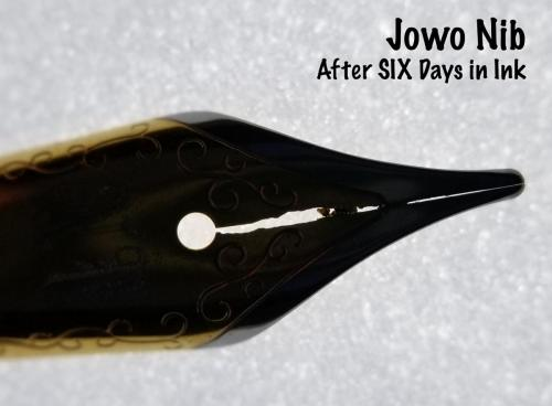 Top view of the Jowo nib after six days in the Aristotle Iron Gall ink. This backlit view very nicely shows the damage to the steel around the nib's slit.