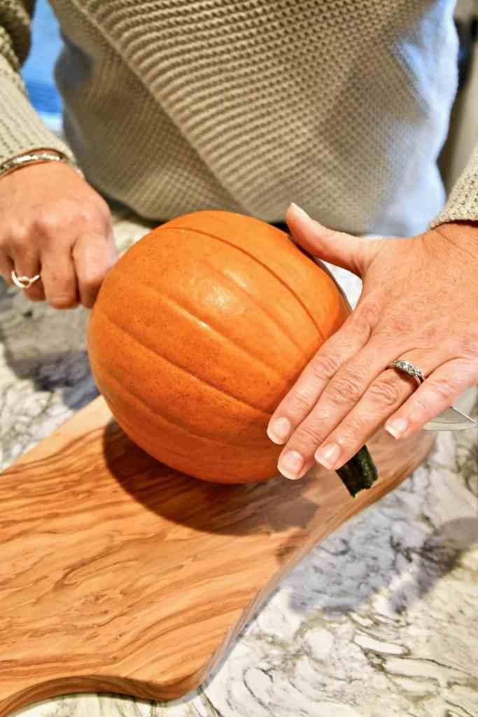 cutting a pumpkin in half
