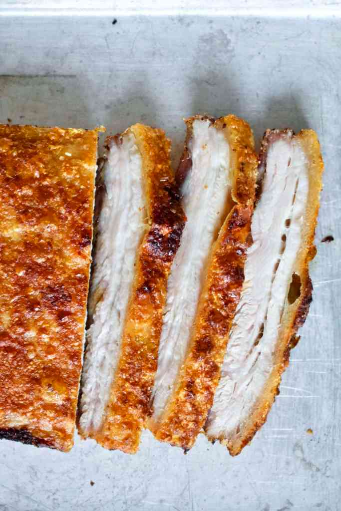 Crispy Pork Belly sliced and on a sheet pan