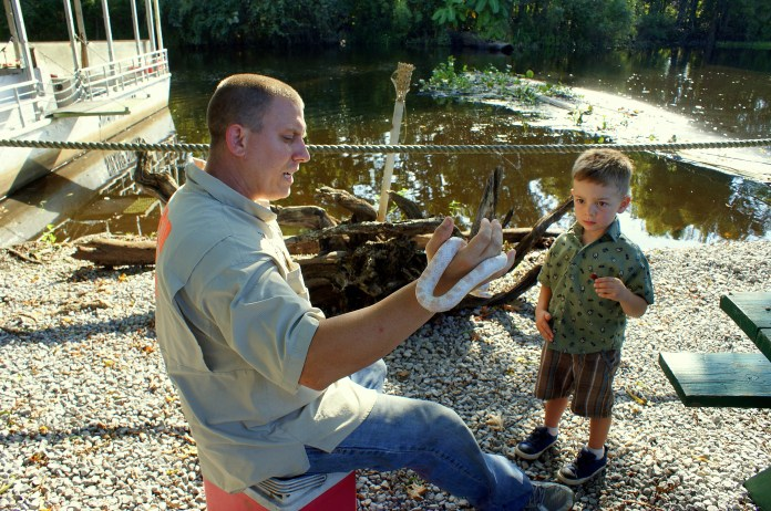 Discovering an albino snake in the swamps of Louisiana. Photo/Kendra Yost