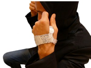 Model wearing sterling silver hand Cuff and a black hoody