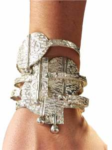 Model wearing five Sume and Sudina bracelets
