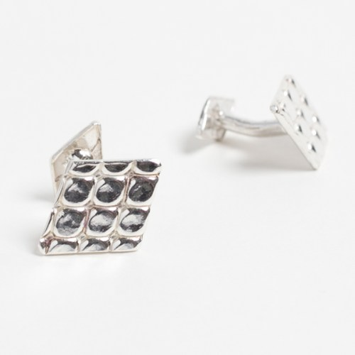 A pair of diamond shaped Marali cufflinks