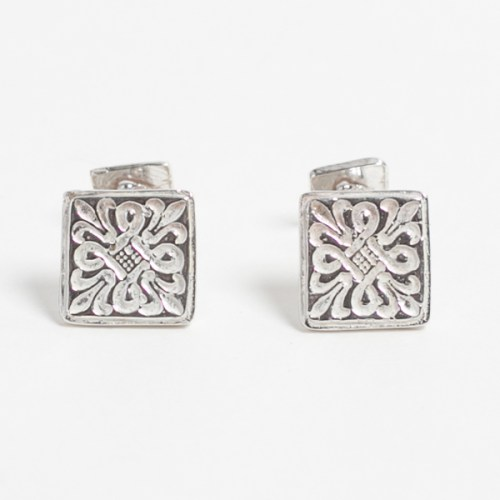 a pair of sterling silver, cufflinks with a design similar to the Fleur De Lys