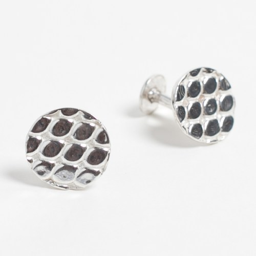 A pair of round Kenly Warren Marali cufflinks