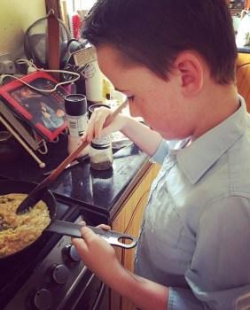 Ruairi helping to make scrambled eggs