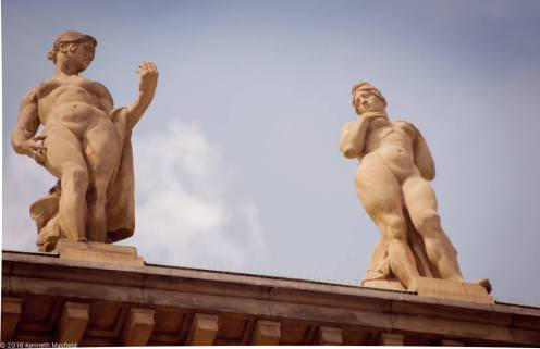 Hot statues atop Charles University in Prague