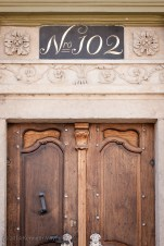 Elegant door with No. 102 above it