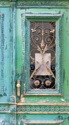 Door with weathered green and blue-green paint
