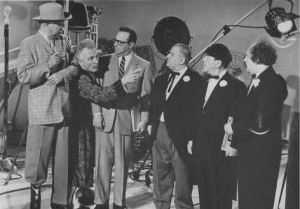 Emil Sitka (second from left)  in The Three Stooges in Orbit.
