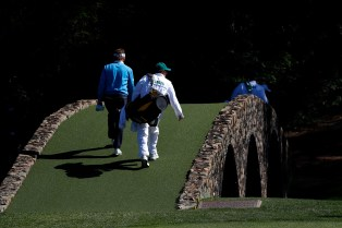 AUGUSTA, GEORGIA - APRIL 09: Bernhard Langer of Germany and caddie Terry Holt walk across the Hogan bridge to the 12th green during the third round of the 2016 Masters Tournament at Augusta National Golf Club on April 9, 2016 in Augusta, Georgia. (Photo by Kevin C. Cox/Getty Images)