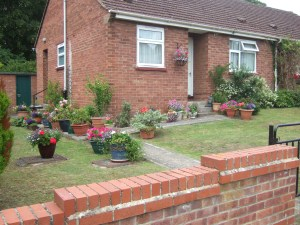 Lawn surrounded by planter pots