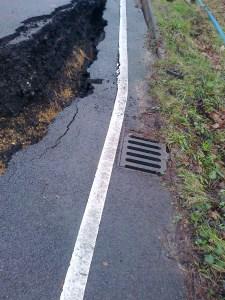 Drain and white edge marking falling away
