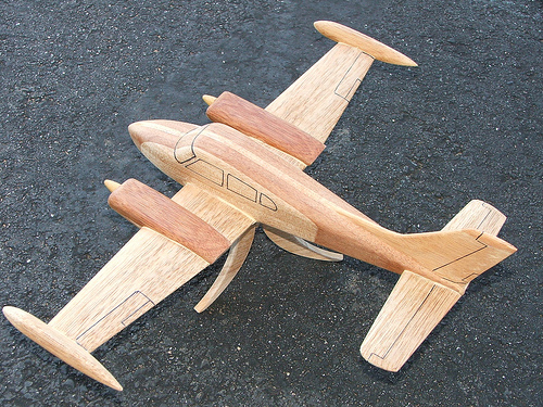 Plane carved from wood