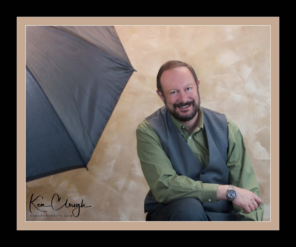 Welcome to Ken's Portrait Photography. I am so happy that you are here. Hi, I am Ken Clough, the owner and founder of Ken's Portrait Photography. I am a lifelong photographer and educator. As an educator, I have created new knowledge and educated so many students. As a photographer, I have created award-winning images that for so many satisfied clients. To me, photography is an art form. It is not just capturing an image in the camera lens, but taking that image and making into something more. As a photographic artist, I am always pushing myself and my studio contributors to do more, to be better, and to expand our creativity. Whether it is adjusting an image in post-production or getting a creative team together for a large production shoot, I always want to create a better image today than I did yesterday.