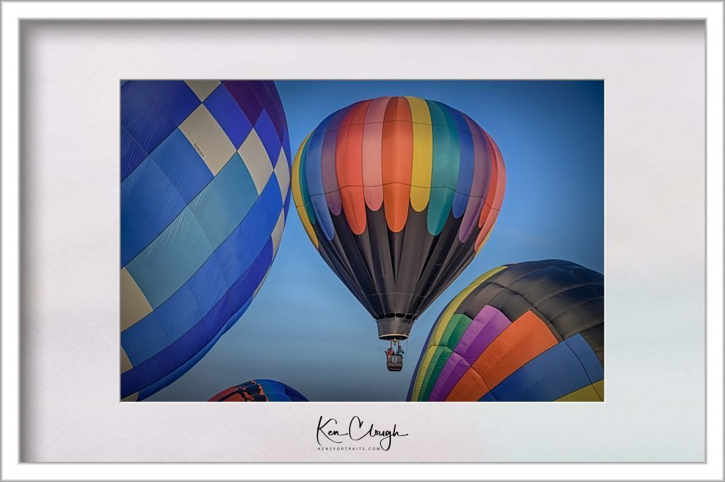 Adirondack Hot Air Balloon Festival - Photographer's Haven by Kens Portrait Photography. The Adirondack Hot Air Balloon Festival is one of the great fall traditions of the New York State Capital District Region. Many an area resident will make the dark pre-dawn trek on the cool crisp autumn mornings to see the scores of hot air balloons inflate and launch. Of course, the Adirondack Hot Air Balloon Festival is also a haven for photographers. When you walk around the balloon festival you can see all of the photographers taking pictures of the grand hot air balloons. There is so much to photograph - the flight crews preparing the balloons for launch, the inflating of the hot air balloons, and of course, the graceful ascent of each majestic balloon. To take full advantage of the day from a photographer's perspective requires a very early start to the day. Today was one of those days for me and Kens Portrait Photography. Up at 2 am in the morning to prepare myself and my equipment for a 3 am a departure. An hour drive up to Floyd Bennett Memorial Airport in Glens Falls. Arrive around 4 pm waiting for the gates to open. The delicious Big Balloon Breakfast starts at 5 pm and the balloons begin launching at 6:30 pm.
