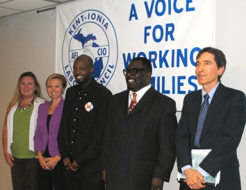 Lisa Bennett (right) stands with Grand Rapids mayoral candidates after a forum organized by the KICLC Women's Caucus. July 2015