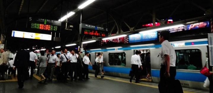Shimbashi station men walking