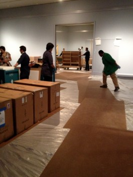 The special exhibition space has been carpeted for this show so in order to move the cart the floor has to be covered with masonite.