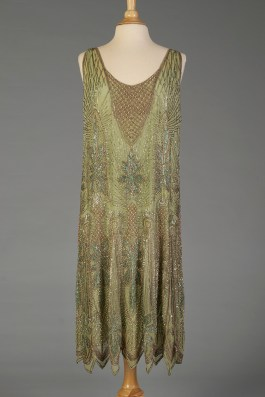 The new photograph of the beaded green silk chiffon dress with accession number 1996.58.346 ab. The dress is attributed to Paul Poiret.
