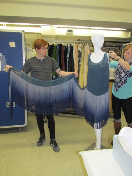 Our Student Assistants Larry Staats and Chloe Wingard demonstrate how the dress is put together.